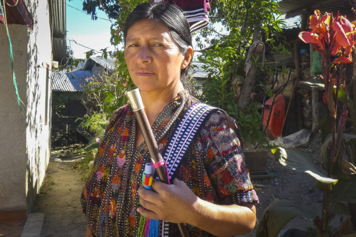 Micaela Soch, seen here holding her community mayor stick, says she hopes more women, especially those who have university degrees, will participate in local politics in the future. (Photo by Norma Baján Balán, GPJ Guatemala)