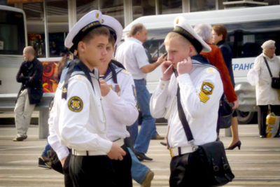 Young men in Russian navy uniforms outside a Moscow train station. (Photo by Joe Kilroy)
