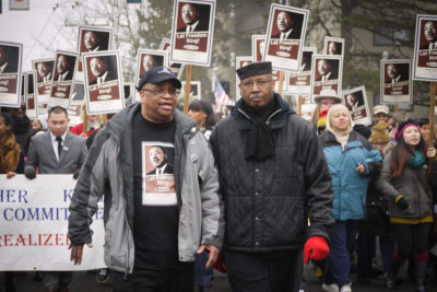 King County Councilmember Larry Gossett and Civil Rights Activist Tony Orange at the head of the march in 2013. (Photo by Susan Fried)