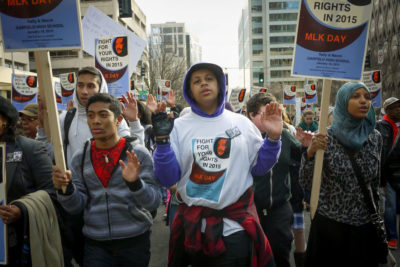 """""""Hands Up, Don't Shoot"""" was a rallying cry following a year of police violence and unrest in places like Ferguson, Missouri. (Photo by Susan Fried)"""