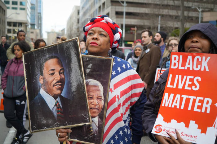 Fai Mathews was back again in 2016 with her pictures of MLK and Mandela, alongside a Black Lives Matter sign. (Photo by Susan Fried)