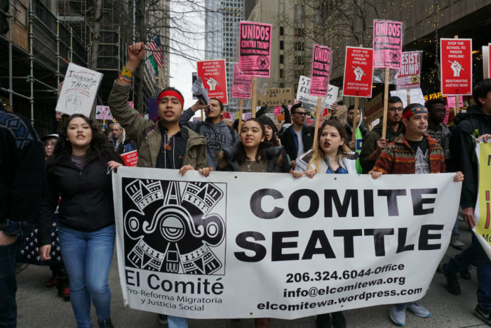 "Arellano-Martinez, second from left, marched down Jackson Street to Westlake Park alongside immigrants and allies chanting ""la gente unida, jamas sera vencida."" (Photo by Agatha Pacheco)"