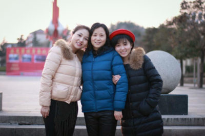 Ping Xu, left, with her mother and sister. (Courtesy photo)