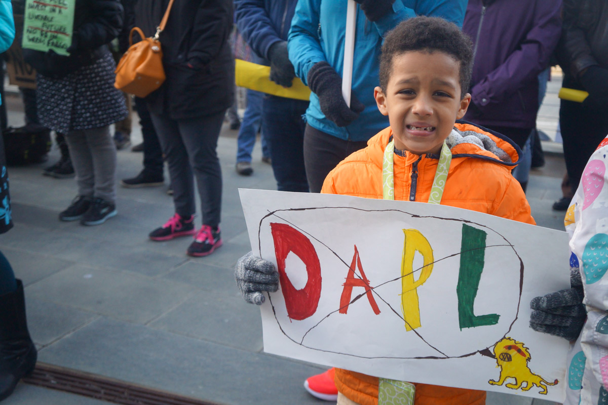 Demonstrators of all ages gathered in the plaza brandishing handmade anti-DAPL signs. (Photo by Aly Brady)