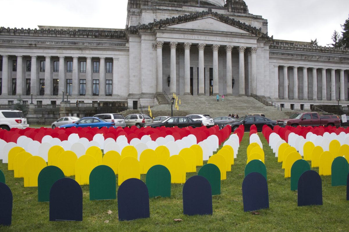A mock graveyard created by Forefront, innovations for suicide prevention, on the lawn of the state capitol building last month. (Photo by Jill Christensen)