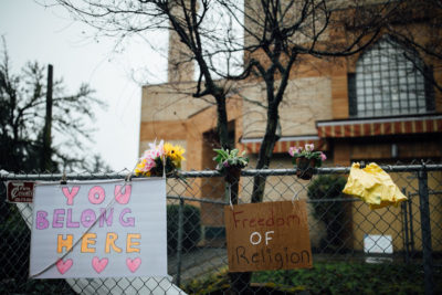 Posters of support placed by neighbors outside the mosque. (Photo by Julia-Grace Sanders)