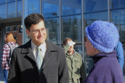 Andres Salomon talks with a supporter outside the UW Light Rail Station Wednesday after announcing that he's running for mayor. (Photo by Katie Anastas)