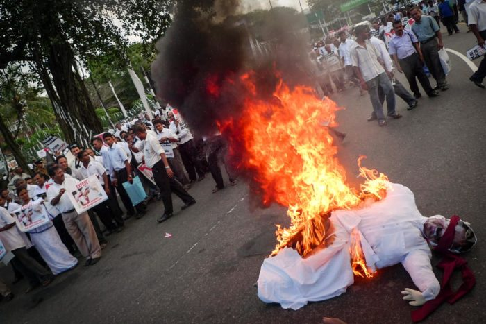 Demonstrators at the funeral of Lasantha Wickrematunge, an assassinated Sri Lankan journalist, burn an effigy of the Sri Lankan President Mahinda Rajapaksa in 2009. (Photo by Indi Samarajiva)