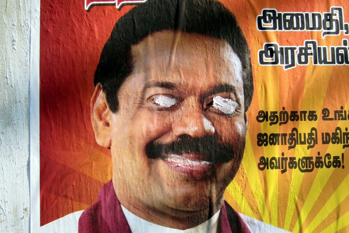 Campaign posters of Mahinda Rajapaksa with the eyes scratched out. (Photo by Indi Samarajiva)