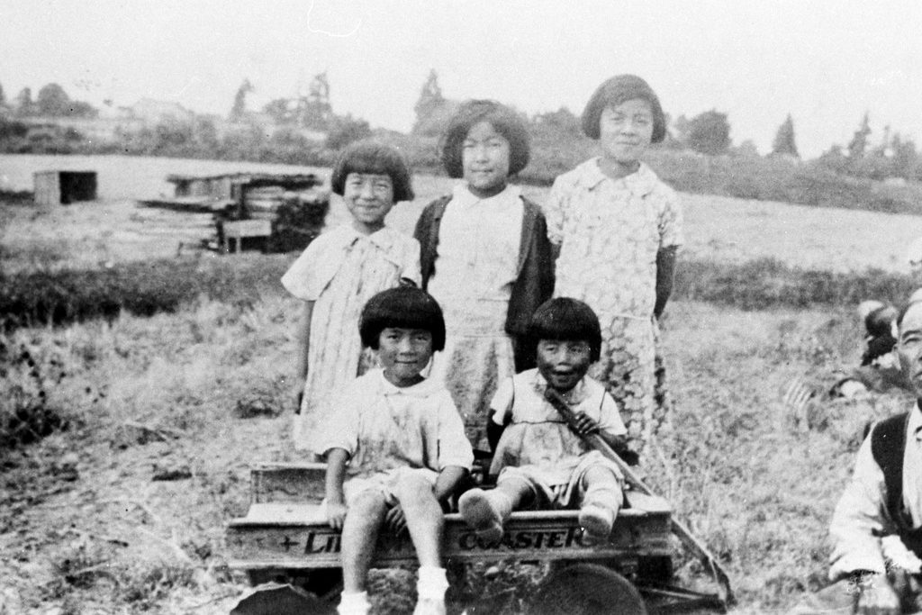 The Suguro farm was located in the Midlakes area of Bellevue, Washington. Front (left to right): Sumie and Toshi Suguro. Back: Mae Suguro, Eva Aramaki, and Mitsue Suguro. (Photo courtesy Densho.)