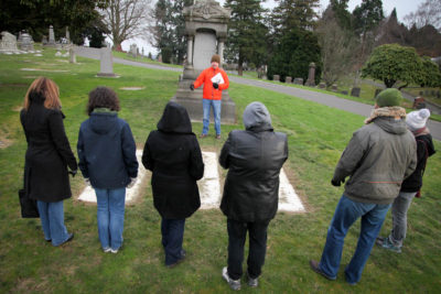 xxxx leads a tour of the Lake View Cemetery, where historical figures from Seattle's early years are buried. (Photo by Alex Stonehill)