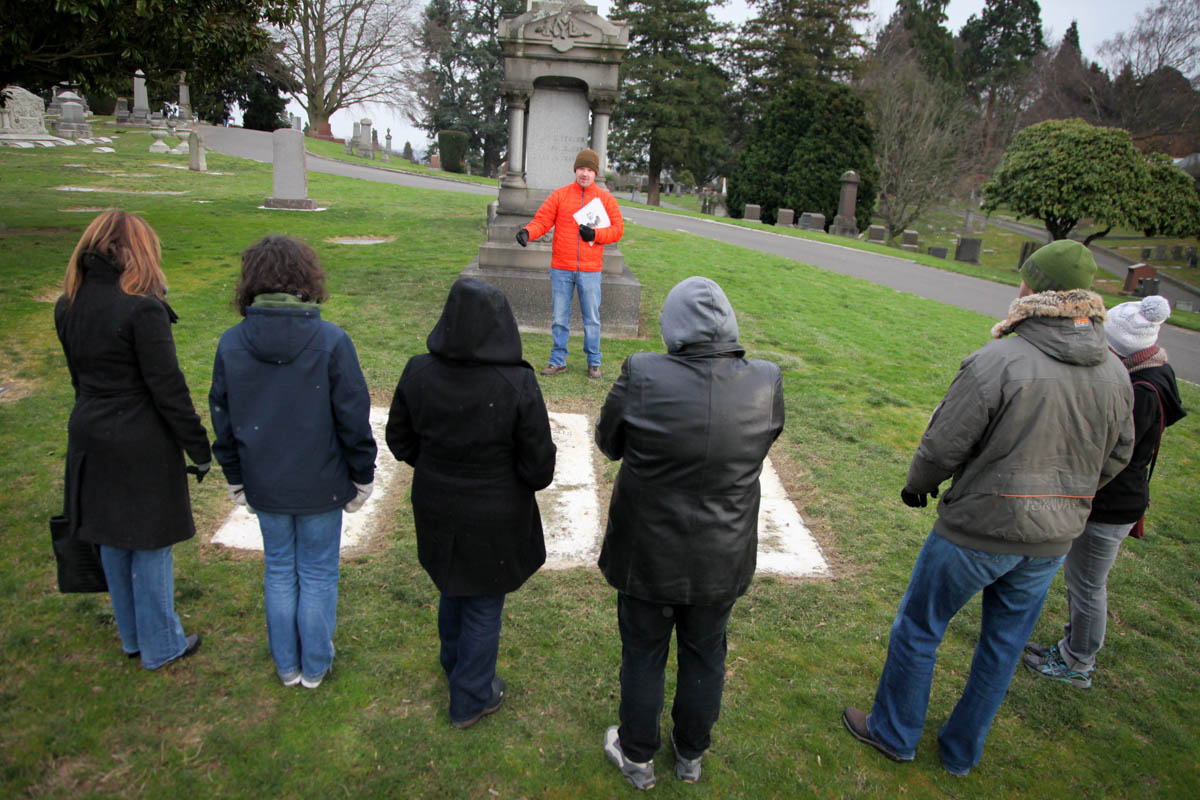Historian Jared Steed leads a tour of the Lake View Cemetery, where figures from Seattle's early years are buried. (Photo by Alex Stonehill)