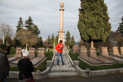 Steed stands on the tomb of the Denny family, the first white settlers in Seattle. (Photo by Alex Stonehill)