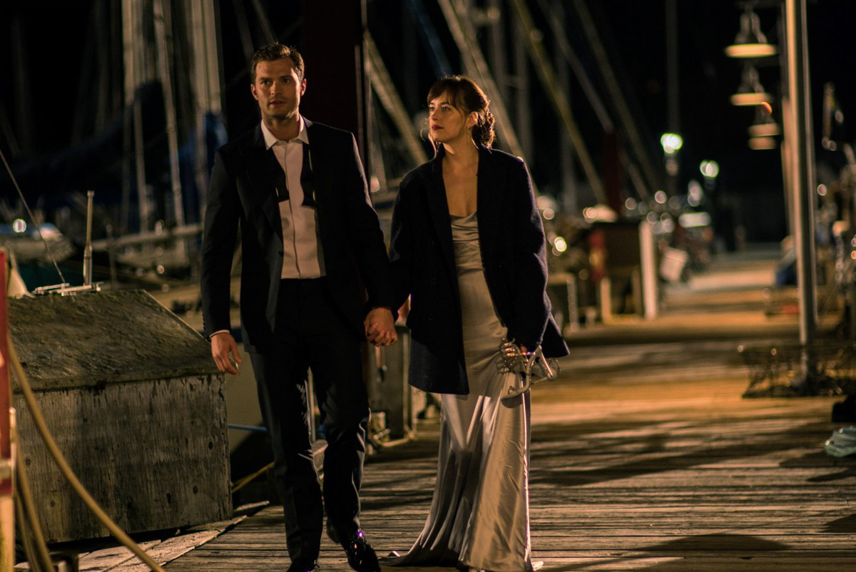 "Jamie Dornan and Dakota Johnson take a moonlight walk on a Seattle dock in ""50 Shades Darker."" Most of the film was actually shot in Vancouver, where film incentives make it much cheaper. (Photo by Doane Gregory/Universal Pictures)"