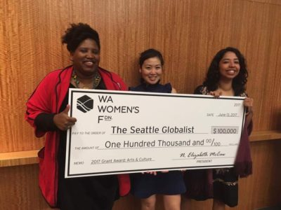 Columnist Reagan Jackson, Education Director Christina Twu, and Board Vice President & Globalist Apprenticeship alum Esmy Jimenez collected this novelty check (representing the largest grant the Globalist has received to date!) from the Washington Women's Foundation in June 2017.