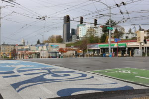 A new mural painted on the crosswalks of 12th and Jackson in July 2017 looks onto the Seattle skyline. The crosswalk sits at the entrance of Little Saigon and represents many aspects of Vietnamese culture.