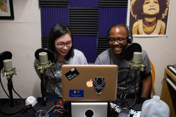 "Domonique Meeks,30, and Yoshi Ueda, 33, prepare their equipment for the start of their podcast. Their show, ""No Blueprint,"" gives a platform to people of color to tell stories. Photo credit: Bryan Nakata."