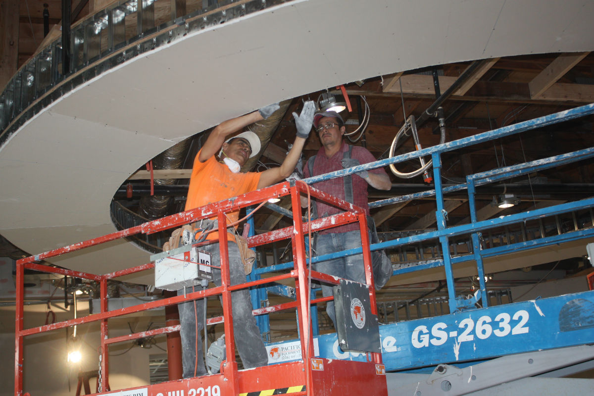 Workers in the museum's rotunda. (Photo by John Stang)