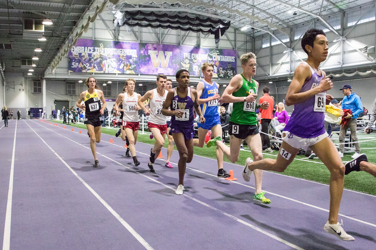 Tibebu Proctor, 19, jockeys for position on a the straightaway during the Men's 5,000 meters at the Husky Classic. After two productive seasons of cross country, Proctor is in the middle of his first year running track after redshirting as a freshman.