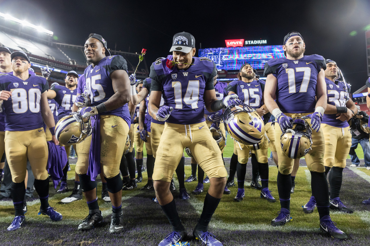 Jojo McIntosh dances while celebrating Washington's Pac-12 Championship victory against Utah in Levi Stadium. McIntosh, who is half Cambodian, is one of the wave of new Asian American athletes hoping to make it to the professional level of sports. Photo Credit: Conor Courtney